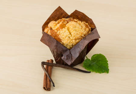 fresh baked: Fresh baked muffin on the wood background