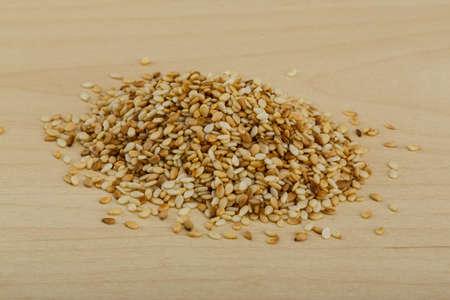 roasted sesame: Roasted sesame seeds on the wood background