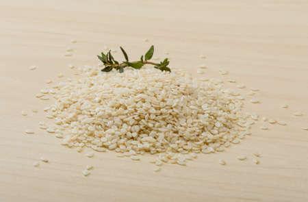 white sesame seeds: White Sesame seeds on the wood background