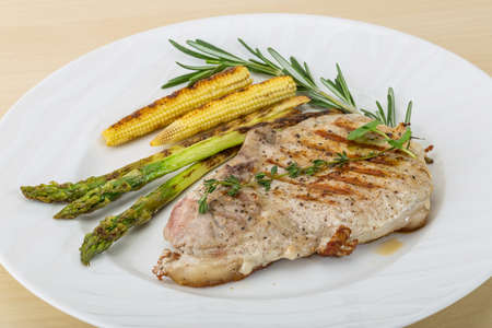 baby cutlery: Pork steak with grilled asparagus and baby corn