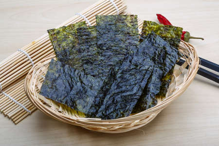 iodine: Nori sheets with sticks on the wood background