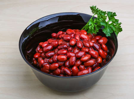 lima beans white beans: Baked red beans with parsley on the wooden background