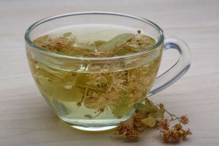 linden tea: Linden tea in the glass on wood background Stock Photo