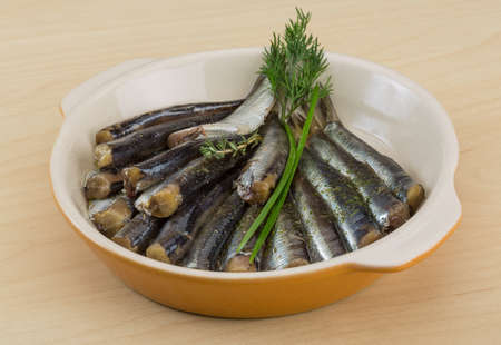 Salted anchovy with spices and herbs - ready for eat photo