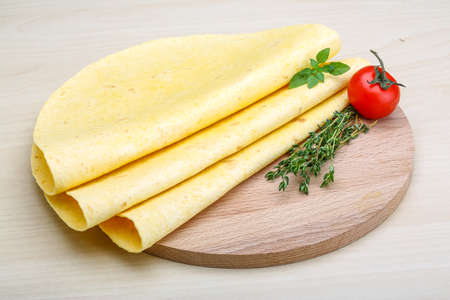 latin food: Tortilla stack with herbs on the wood background