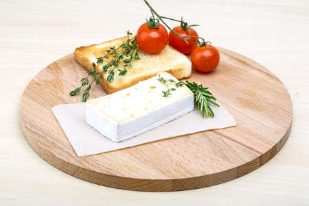 brie: Soft brie cheese with rosemary, thyme and toast bread