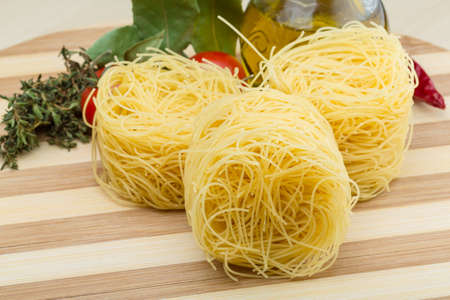 Raw Round vermicelli on the wood background photo