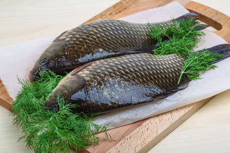 crucian: Two crucian with dill ready for cooking Stock Photo