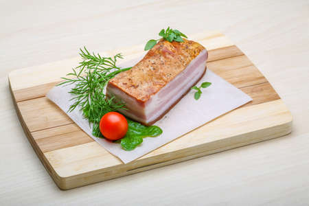 raw bacon: Raw bacon with herbs and spices on wood Stock Photo