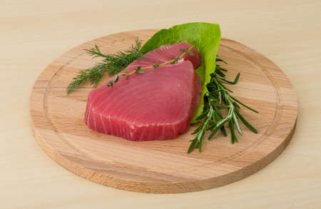ahi: Raw tuna steak with rosemary and thyme Stock Photo