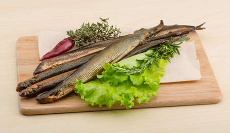 delicacy: Smoked Lamprey - seafood delicacy with salad and herbs Stock Photo