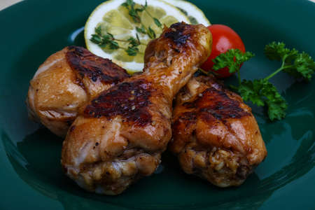 sause: Roasted chicken legs in teriyaki sause with thyme Stock Photo