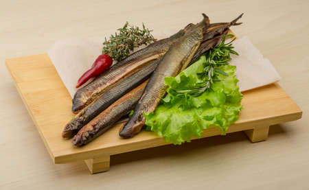 organisms: Smoked Lamprey - seafood delicacy with salad and herbs Stock Photo