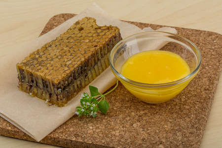 honey comb: Honey with comb on the wooden background