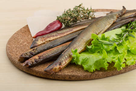 paling: Smoked Lamprey - seafood delicacy with salad and herbs Stock Photo