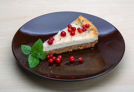 Cheesecake with berries and fresh mint branch photo