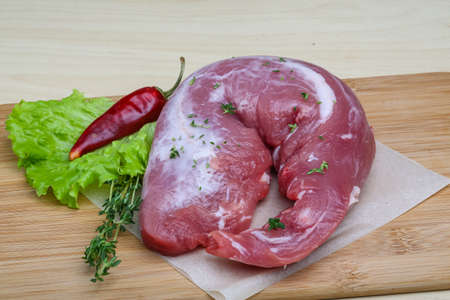 tenderloin: Raw pork tenderloin with thyme and pepper - ready for cooking
