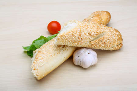 life loaf: Fresh crust Baguette with sesame seeds and salad Stock Photo