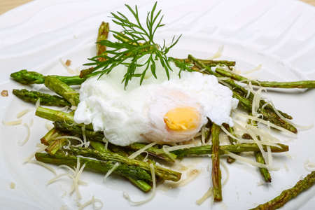benedict: Benedict egg with grilled asparagus and parmesan Stock Photo