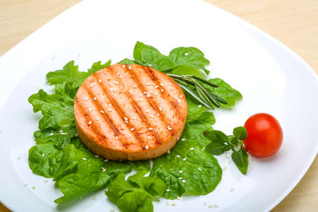 fresh food fish cake: Salmon burger cutlet with sesame seeds and salad