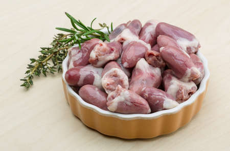 innards: Raw chicken hearts with thyme and rosemary - ready for cooking