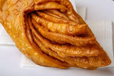 baklawa: Sweet Baklava with honey on the plate Stock Photo