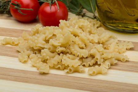 gallo: Raw Italian Pasta Creste di gallo on wood background
