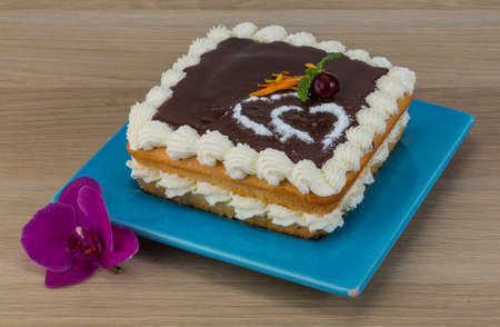 chocolate icing: Valentine Chocolate icing cake with flower and hearts Stock Photo