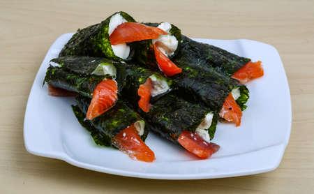 sake maki: Roll with salmon, nori and soft cheese