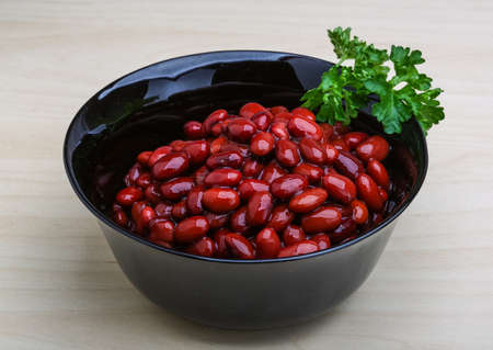 lima bean: Baked red beans with parsley on the wooden background