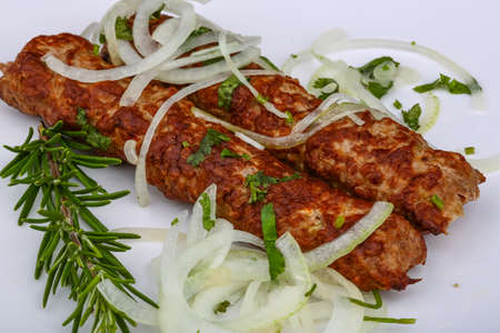 kabab: Beef Kebab with onion rings and rosemary Stock Photo