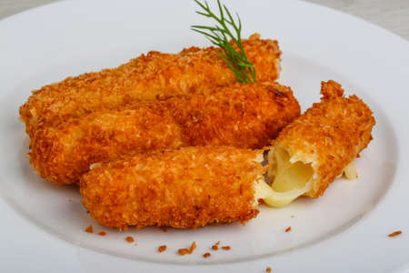 Fried cheese sticks in pan with dill Banco de Imagens