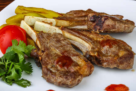 rack of lamb: Grilled Lamb chops with eggplant and coriander leaves Stock Photo