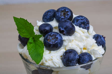 mascarpone: Blueberry with mascarpone cheese served mint leaves Stock Photo