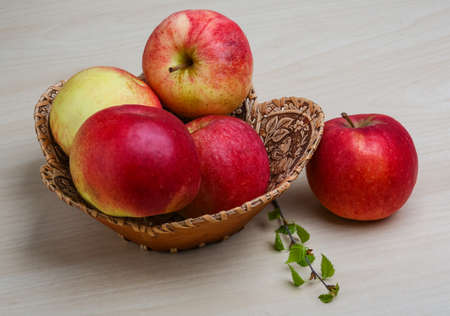ambrosia: Few apples in the basket on wood backgrond