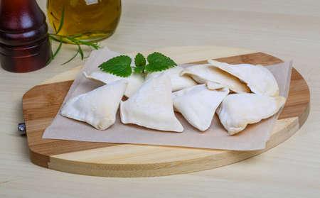 raw potato: Raw potato dumplings - Ukrainian Vareniki served dill branch Stock Photo