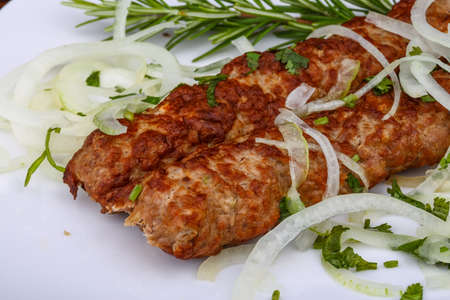 seekh: Beef Kebab with onion rings and rosemary Stock Photo