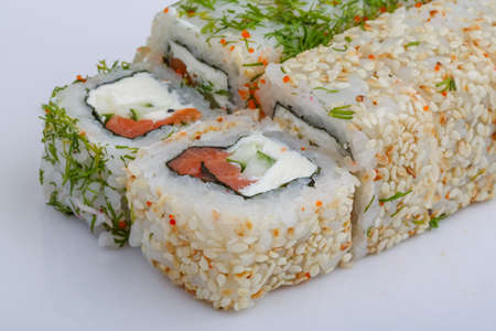 california roll: California roll - Japan traditional cusine with dill and sesame seeds