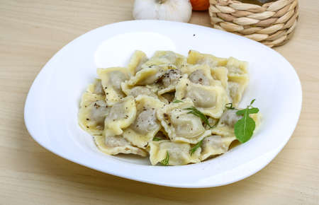 Italian dumplings Ravioli with fresh herbs and spices Stock Photo