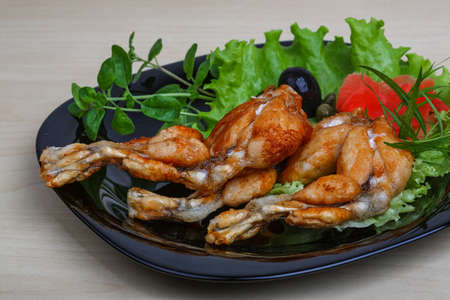 lunch tray: Fried frog legs with olive, herbs and spices