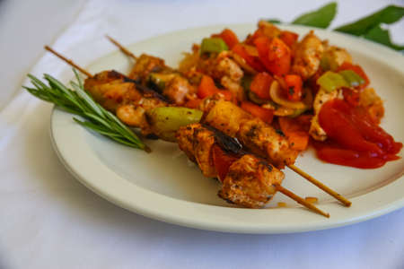 kabab: Bbq with meat and vegetables served rosemary branch