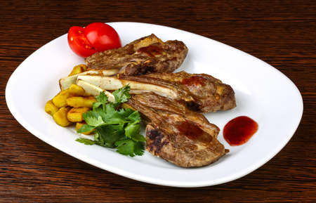 mutton chops: Grilled lamb chops with sauce and coriander leaves