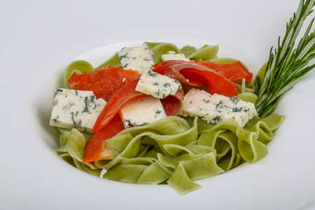 cream and green: Pasta with salmon and blue cheese served rosemary Stock Photo
