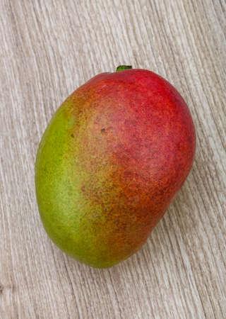 mango: Fresh ripe mango fruit on the wood background