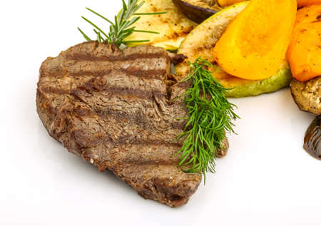 veal: Grilled Veal steak with rosemary and vegetables Stock Photo