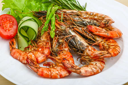 fried food: Grilled prawns with asparagus, rosemary and salad leaves Stock Photo