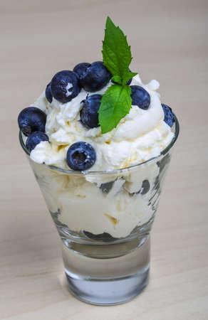 mascarpone: Blueberry with mascarpone cheese served mint leaves Stock Photo