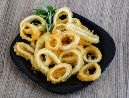 squid: Tempura - squid rings served green onion and rucola leaves Stock Photo