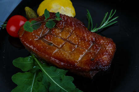 Roasted duck breast with rosemary and rucola