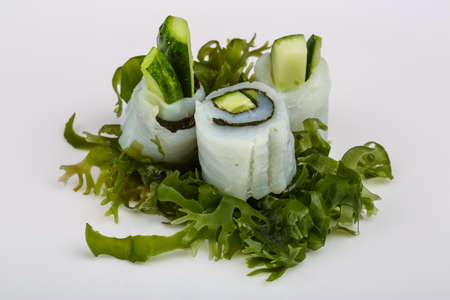 Cold Squid sashimi with cucumber and nori Stock Photo